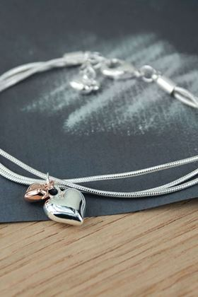 Picture of Pom Triple Chain Bracelet with Hearts